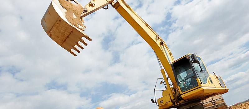 excavator machine at excavation earthmoving work in sand quarry